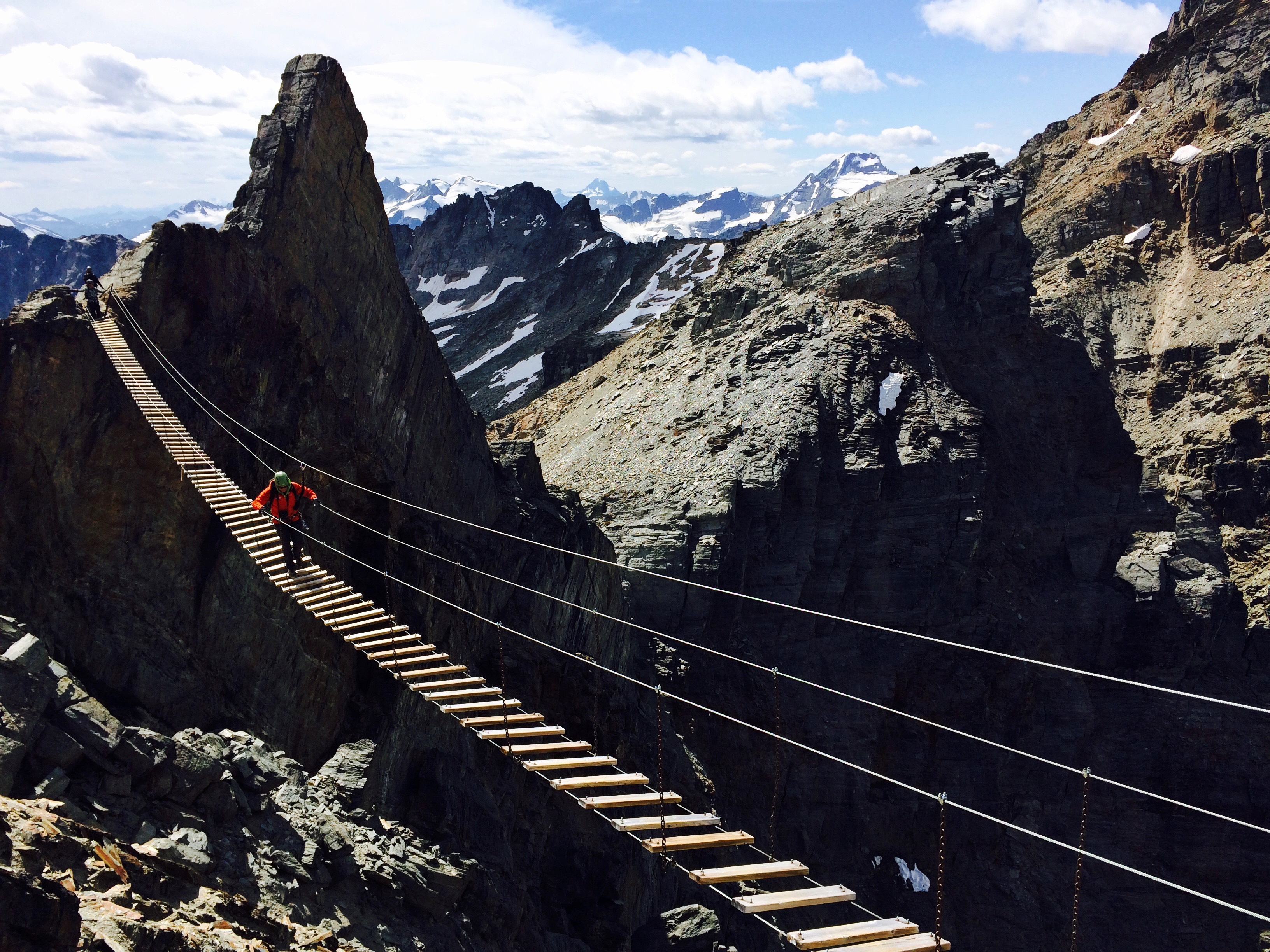 Purcell Mountains| Picture of Brian Walking Across Bridge In Purcell Mountains