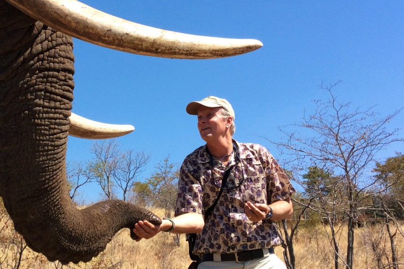 Brian Keating Conservation Endowment | picture of Brian Keating feeding an elephant