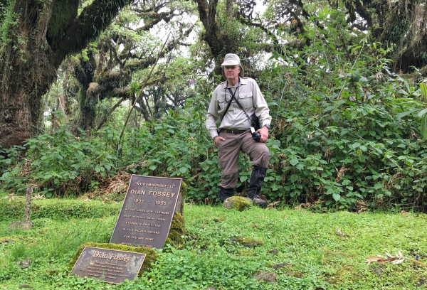 Brian standing at Dian Fossey's grave